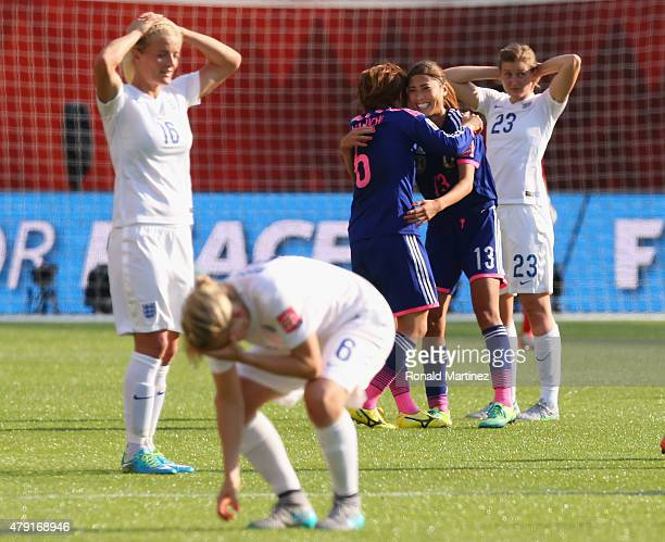 Mizuho Sakaguchi and Rumi Utsugi of Japan celebrate after the FIFA Women's World Cup Semi Final match between Japan and England at the Commonwealth...