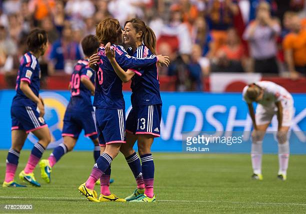 Mizuho Sakaguchi and Rumi Utsugi of Japan celebrate at the final whistle after defeating the Netherlands 21 during the FIFA Women's World Cup Canada...