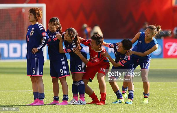 Mizuho Sakaguchi Nahomi Kawasumi Aya Sameshima Ayumi Kaihori Saori Ariyoshi and Yuki Ogimi of Japan celebrate after the FIFA Women's World Cup Semi...