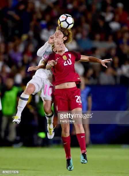 Mizuho Sakaguchi of Japan and Allie Long of the United States collide on a header during a 30 United States win in the 2017 Tournament Of Nations at...