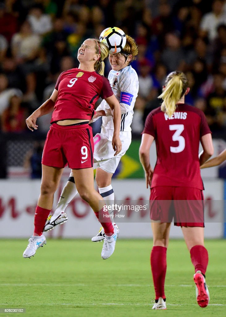 Mizuho Sakaguchi #10 of Japan and Lindsey Horan #9 of the United States collide in front of Samantha Mewis #3 during a 3-0 United States win in the 2017 Tournament Of Nations at StubHub Center on August 3, 2017 in Carson, California.