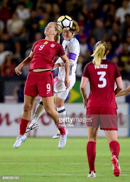 Mizuho Sakaguchi of Japan and Lindsey Horan of the United States collide in front of Samantha Mewis during a 30 United States win in the 2017...