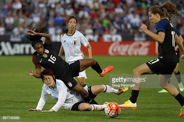 Mizuho Sakaguchi of Japan collides with Crystal Dunn of United States of America as Tobin Heath of United States of America collects the ball during...