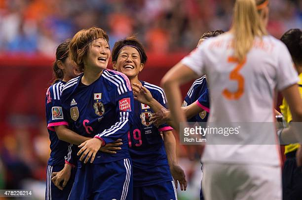 Mizuho Sakaguchi of Japan is congratulated by teammates Nahomi Kawasumi and Saori Ariyoshi after scoring on the Netherlands during the FIFA Women's...