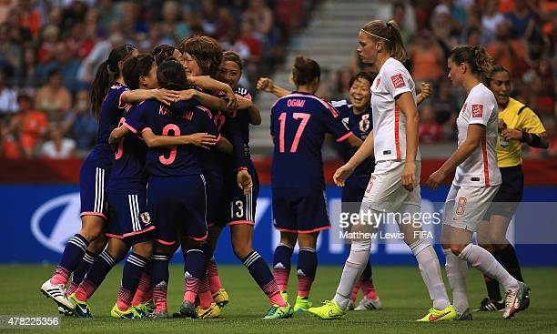Mizuho Sakaguchi of Japan is congratulated on scoring her teams second goal during the FIFA Women's World Cup 2015 Round of 16 match between Japan...