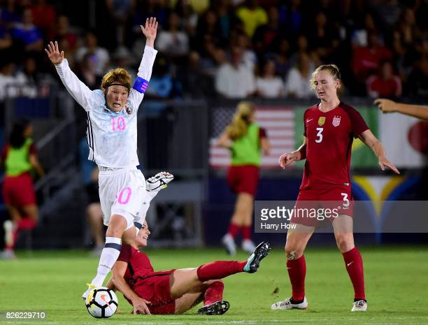 Mizuho Sakaguchi of Japan reacts as she is challenged from behind by Julie Ertz of the United States as Samantha Mewis looks on during a 30 United...