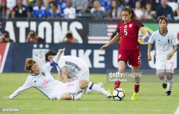 Mizuho Sakaguchi of Japan vies for the ball against Kelley O'Hara of the United States in the first half of a Tournament of Nations game in Carson...