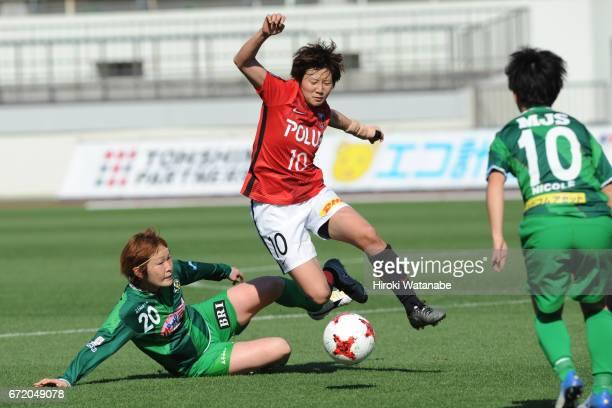 Mizuho Sakaguchi of NTV Beleza and Chinatu Kira of Urawa Red Diamonds Ladies compete for the ball during the Nadeshiko League match between Urawa Red...