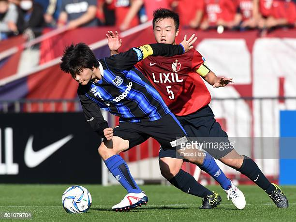 Mizuki Ichimaru of Gamba Osaka Youth and Kenta Chiba of Kashima Antkers Youth compete for the ball during the Prince Takamado Trophy All Japan Youth...