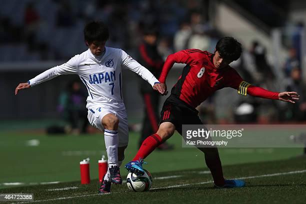 Mizuki Ichimaru of U18 JLeague XI and Kazuki Kubo of High School XI compete for the ball during the Next Generation Match between U18 JLeague XI and...