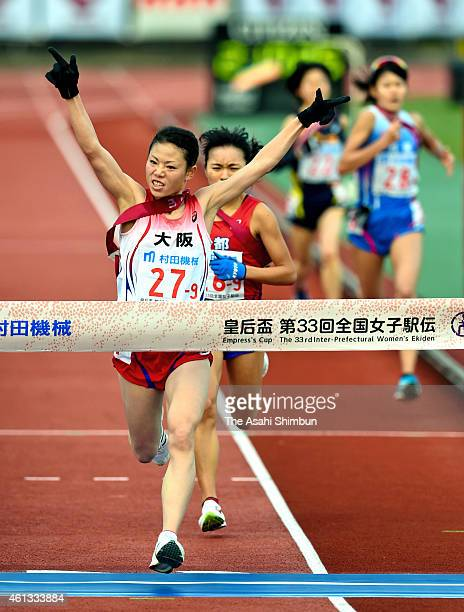Mizuki Matsuda of Osaka crosses the finishing tape to win the Empress's Cup 33rd InterPrefectual Women's Ekiden on January 11 2015 in Kyoto Japan