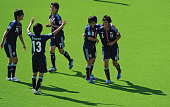 Mizuki Nakamura of Japan celebrates with teammates after scoring a goal during the FIFA U17 Women's World Cup 2012 group C match between Japan and...