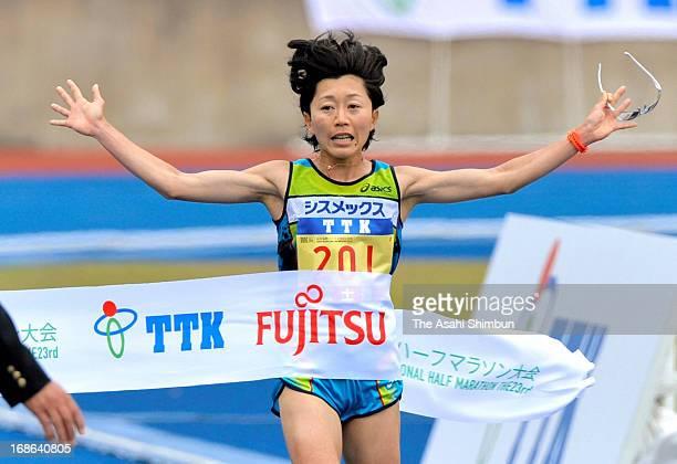 Mizuki Noguchi celebrates winning the Sendai Half Marathon at Sendai City Stadium on May 12 2013 in Sendai Miyagi Japan