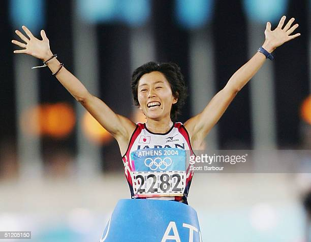 Mizuki Noguchi of Japan celebrates after finishing first and winning the gold medal in the women's marathon on August 22 2004 during the Athens 2004...