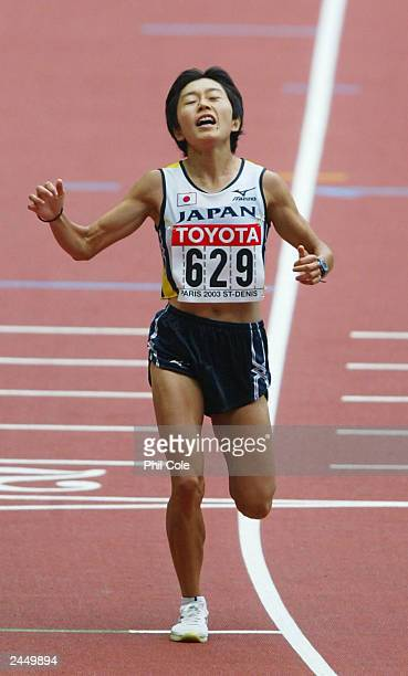 Mizuki Noguchi of Japan celebrates as she crosses the finish line second to win the silver medal during the women's marathon at the 9th IAAF World...