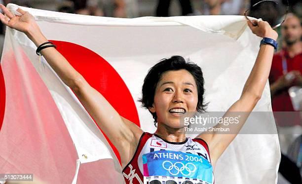 Mizuki Noguchi of Japan celebrates winning the gold at the Women's Marathon at the Panathinaiko Stadium during day nine of the Athens Olympics on...