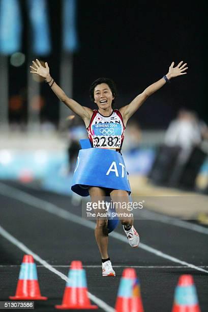 Mizuki Noguchi of Japan celebrates winning the gold in the Women's Marathon at the Panathinaiko Stadium during day nine of the Athens Olympics on...