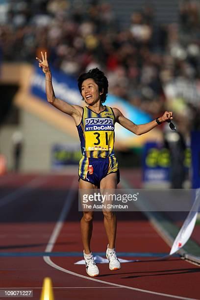 Mizuki Noguchi of Japan crosses the finishing tape to win the 2007 Tokyo International Women's Marathon at the National Stadium on November 18 2007...
