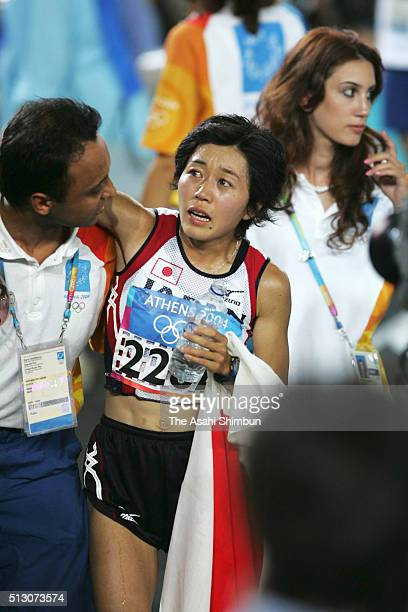 Mizuki Noguchi of Japan reacts after winning the gold in the Women's Marathon at the Panathinaiko Stadium during day nine of the Athens Olympics on...