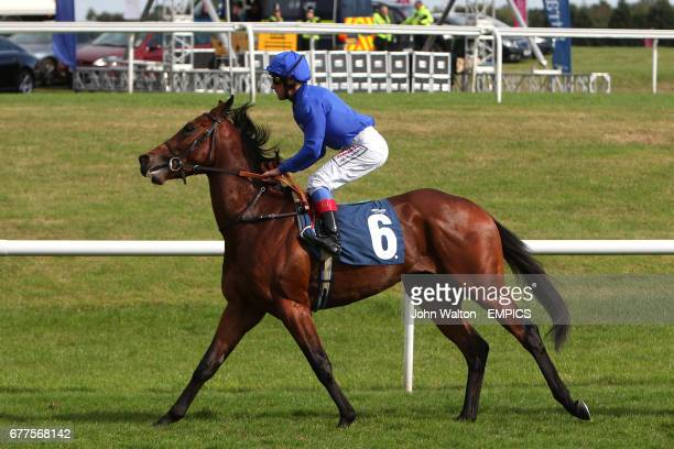 Mizwaaj ridden by Frankie Dettori going to post for the Frank Whittle Partnership Conditions Stakes