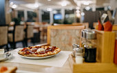 Photo of pizza on the table in a restaurant