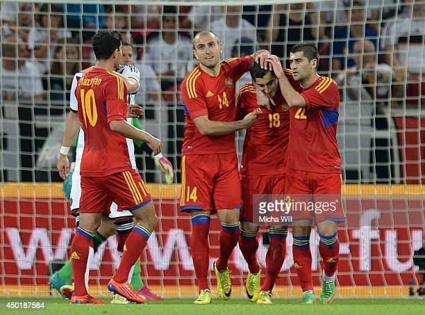 H Mkhitaryan of Armenia celebrates with teammates after scoring his team's first goal during the international friendly match between Germany and...