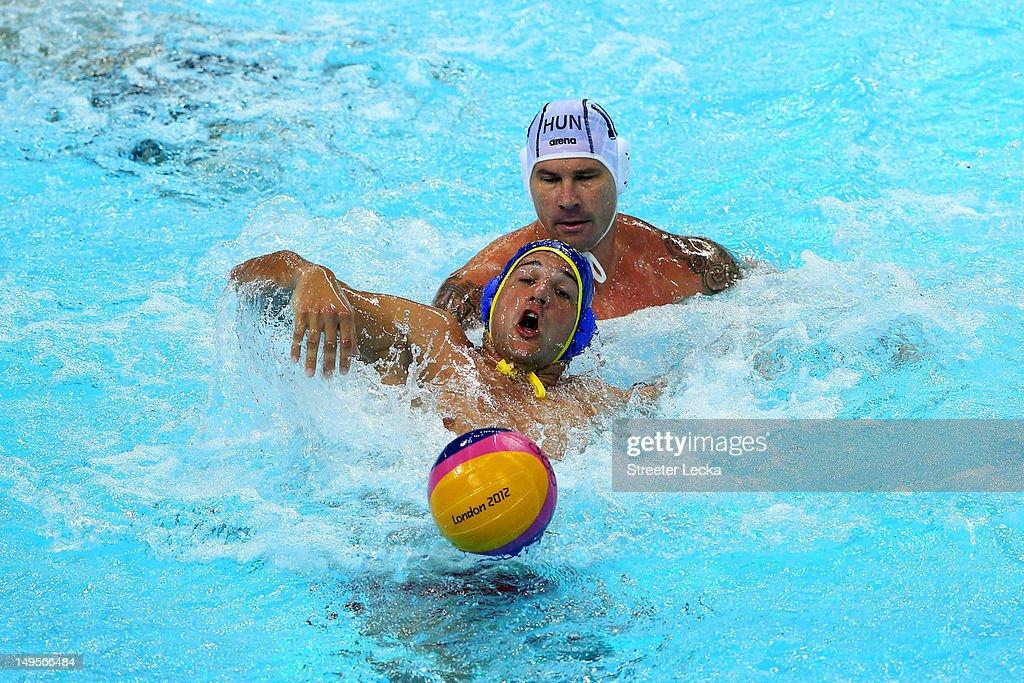 Mladan Janovic (front) #7 of Montenegro battles for the ball with Peter Biros #10 of Hungary during their Men's Water Polo preliminary round Group B match on Day 4 of the London 2012 Olympic Games at Water Polo Arena on July 31, 2012 in London, England.