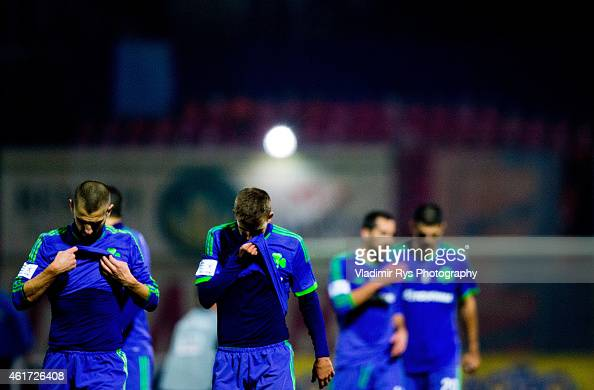 Mladen Petric and his team mate Diamantis Chouchoumis of Panathinaikos leave the pitch for the half time during the Superleague match between...