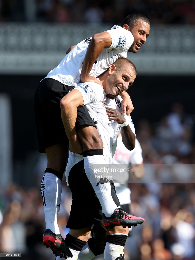 <a gi-track='captionPersonalityLinkClicked' href=/galleries/search?phrase=Mladen+Petric&family=editorial&specificpeople=699883 ng-click='$event.stopPropagation()'>Mladen Petric</a> of Fulham (R) celebrates his second goal with team mate Moussa Dembele during the Barclays Premier League match between Fulham and Norwich City at Craven Cottage on August 18, 2012 in London, England.