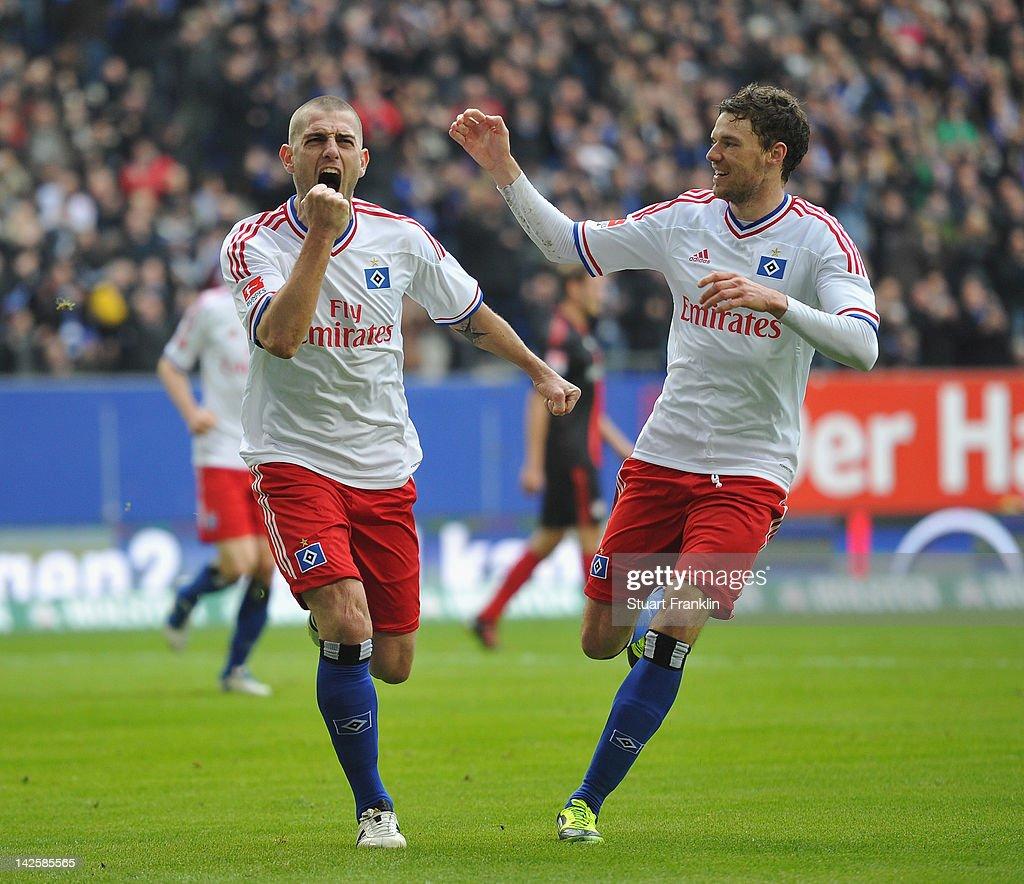 Mladen Petric of Hamburg celebrates scoring his goal with Marcus Berg during the Bundesliga match between Hamburger SV and Bayer 04 Leverkusen at Imtech Arena on April 8, 2012 in Hamburg, Germany.