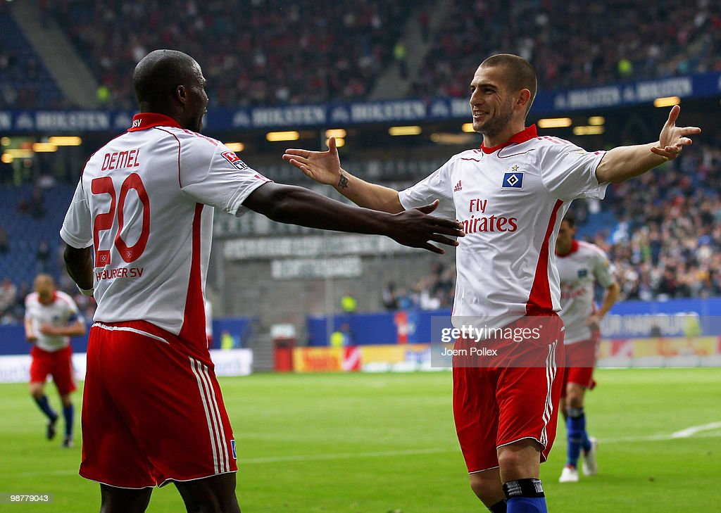 Mladen Petric of Hamburg (R) celebrates with his team mate Guy Demel after scoring his team's second goal during the Bundesliga match between Hamburger SV and 1. FC Nuernberg at HSH Nordbank Arena on May 1, 2010 in Hamburg, Germany.