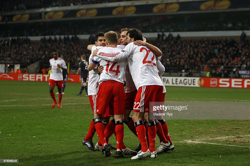 <a gi-track='captionPersonalityLinkClicked' href=/galleries/search?phrase=Mladen+Petric&family=editorial&specificpeople=699883 ng-click='$event.stopPropagation()'>Mladen Petric</a> of Hamburg is celebrated after scoring his team's third goal during the UEFA Europa League round of 16 second leg match between RSC Anderlecht and Hamburger SV at Constant Vanden Stock Stadium on March 18, 2010 in Brussels, Belgium.