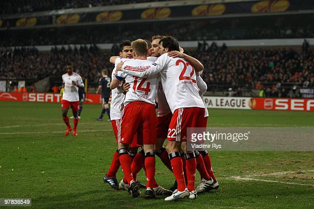 Mladen Petric of Hamburg is celebrated after scoring his team's third goal during the UEFA Europa League round of 16 second leg match between RSC...