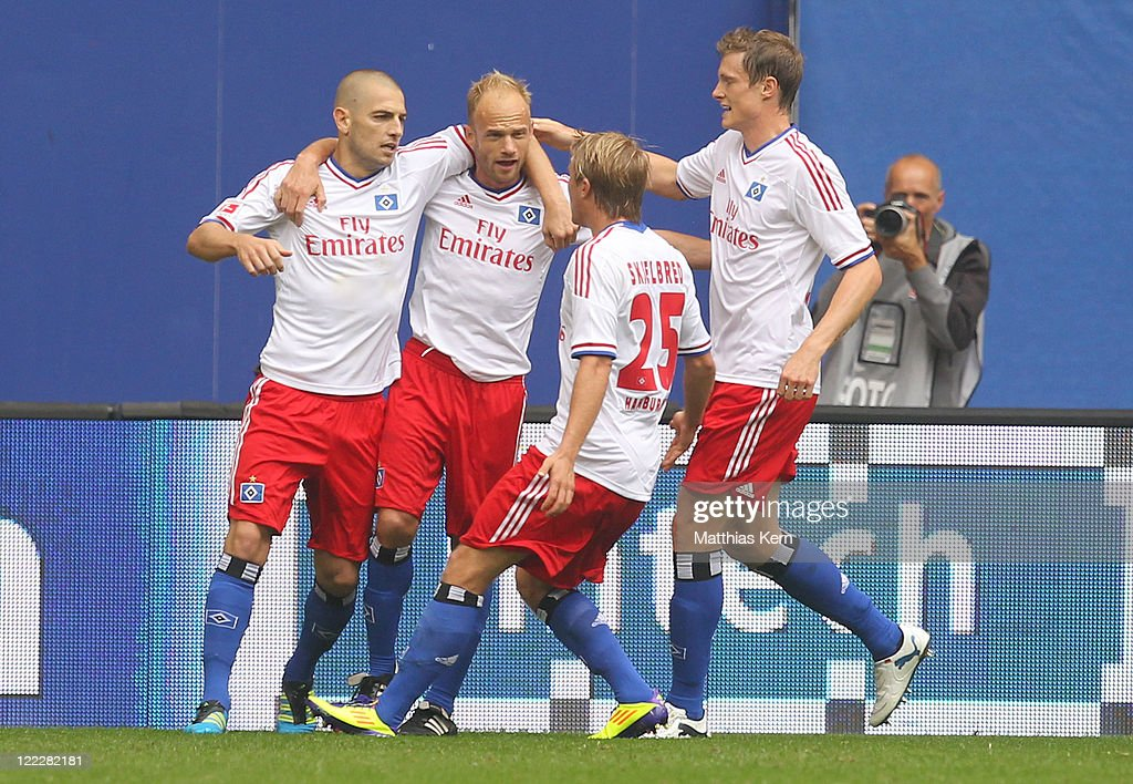 <a gi-track='captionPersonalityLinkClicked' href=/galleries/search?phrase=Mladen+Petric&family=editorial&specificpeople=699883 ng-click='$event.stopPropagation()'>Mladen Petric</a> (L) of Hamburg jubilates with team mates after scoring the first goal during the Bundesliga match between Hamburger SV and 1.FC Koeln at Imtech Arena on August 27, 2011 in Hamburg, Germany.