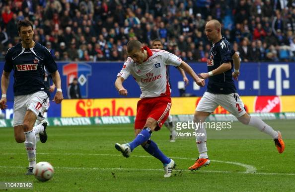 Mladen Petric of Hamburg scores his team's 3rd goal during the Bundesliga match between Hamburger SV and 1 FC Koeln at Imtech Arena on March 19 2011...