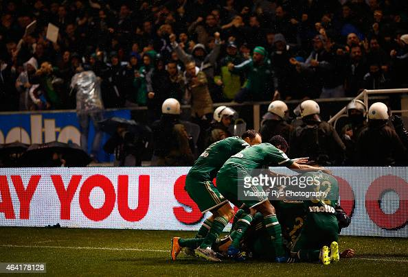 Mladen Petric of Panathinaikos is celebrated by his team mates after scoring his team's second goal during the Superleague match between...