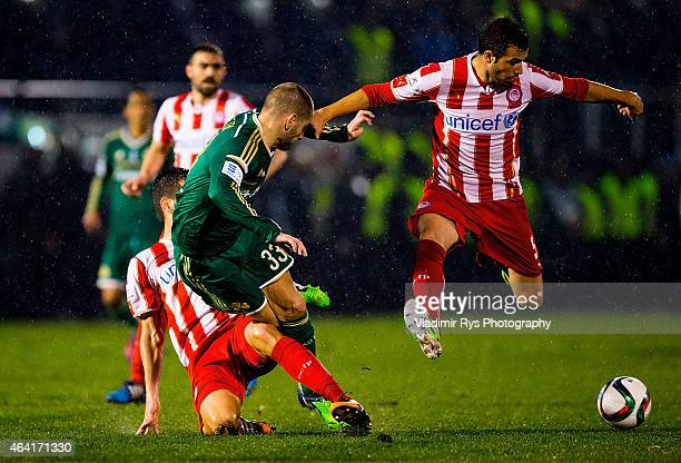 Mladen Petric of Panathinaikos is defended by Dimitris Siovas and Luka Milivojevic of Olympiacos during the Superleague match between Panathinaikos...