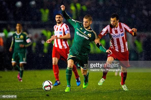 Mladen Petric of Panathinaikos is defended by Luka Milivojevic of Olympiacos during the Superleague match between Panathinaikos FC and Olympiacos at...