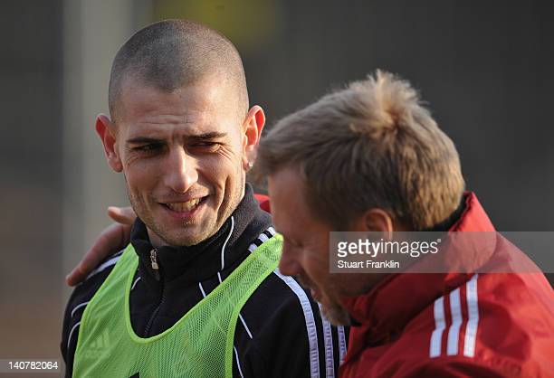 Mladen Petric talks with Thorsten Fink head coach of Hamburg during a training session of Hamburger SV on March 6 2012 in Hamburg Germany