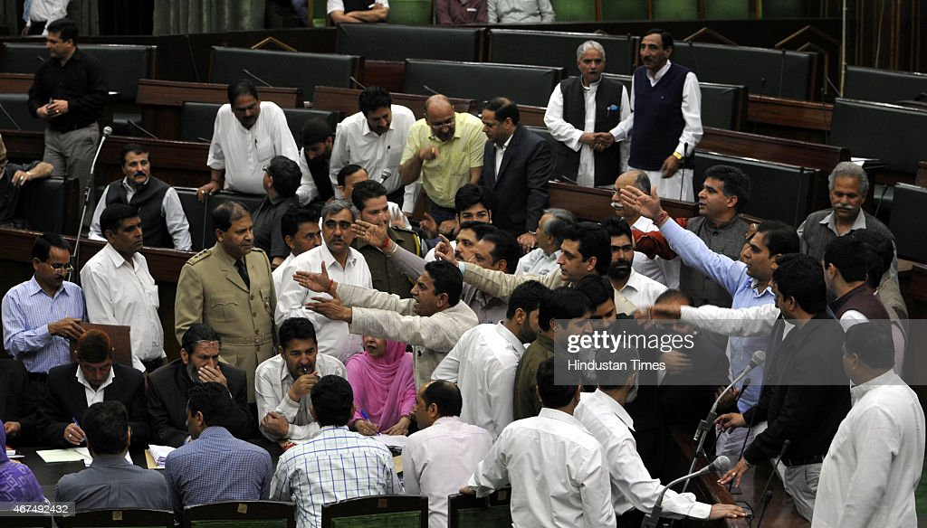 BJP MLAs protesting against National conference MLA Javed Rana remarks against the speaker Kavinder Gupta during a Budget session on March 25, 2015 in Jammu, India. Last evening, National Conference member Javed Rana has accused Speaker Kavinder Gupta of being biased and demanded action against him.
