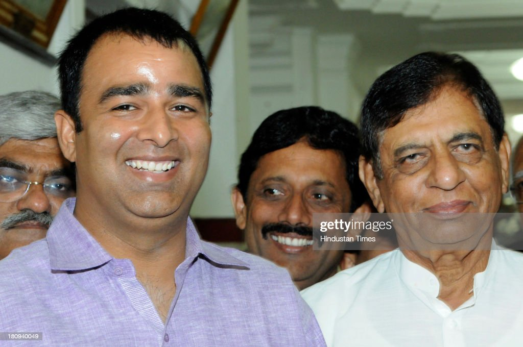 BJP MLAs Sangeet Som and Hukum Singh during Vidhan Sabha session on September 18, 2013 in Lucknow, India. Warrant has been issued against him and other politicians from various parties for instigating the riots that tore through Muzaffarnagar earlier this month, leaving nearly 50 people dead and forcing 40,000 people into refugee camps. Defending the MLAs from her party BJP leader Uma Bharti demanded full enquiry before politicians from her party are arrested.