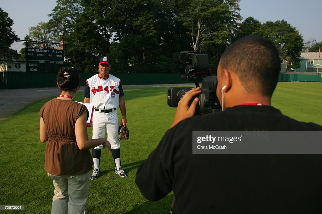 A MLB.com camera crew interviews Hall of Fame member Ryne Sandberg during the Play Ball with Ozzie Smith Clinic held at Doubleday Field on July 27, 2007 in Cooperstown, New York.