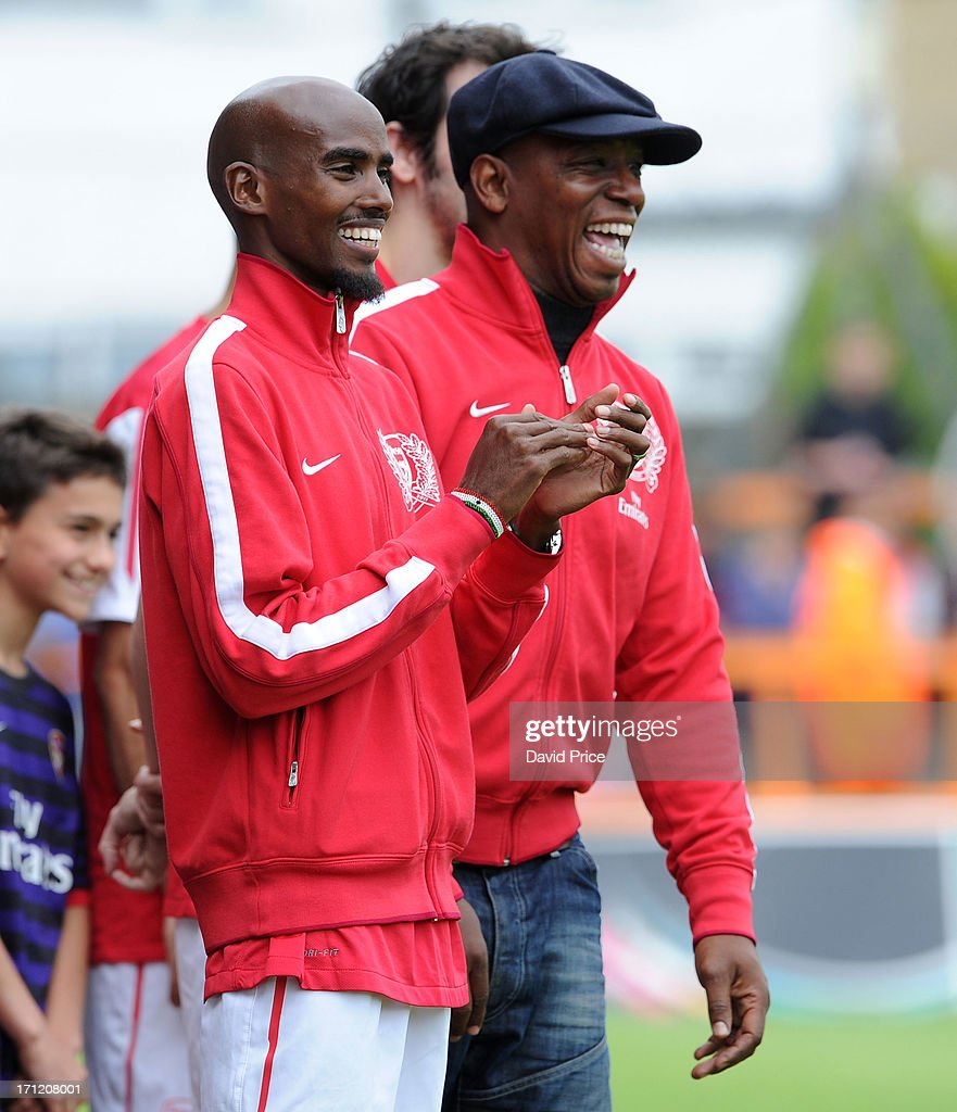 MManager Mo Farah and Ian Wright of Arsenal Legends XI take part in the charity football match between Arsenal Legends XI and World Refugee...