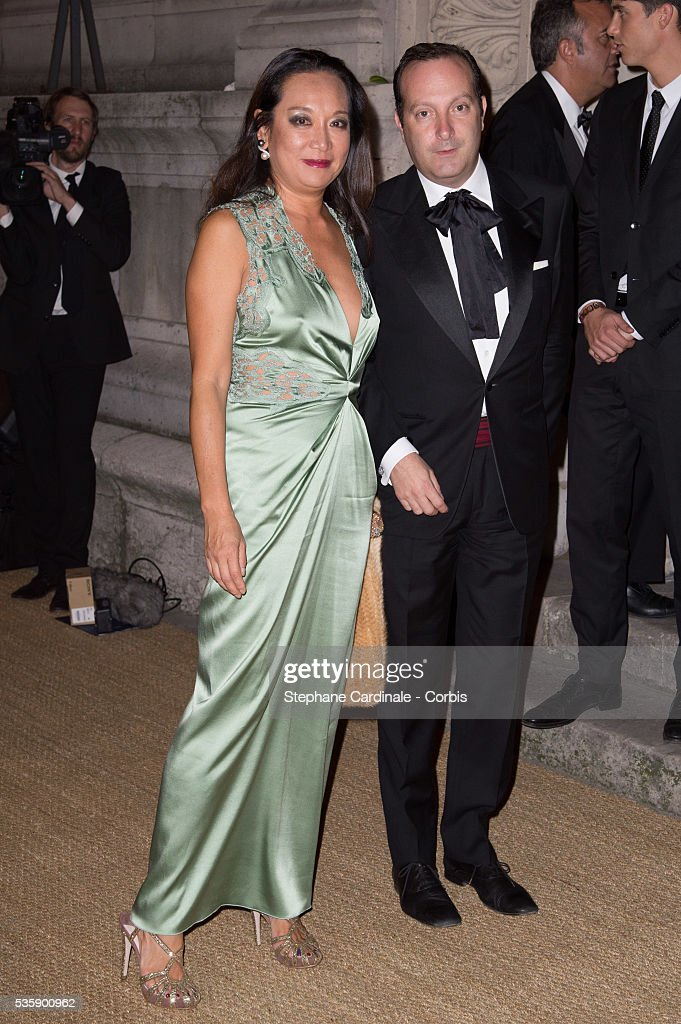 Mme Gilles Hennessy and guest arrive at a Ralph Lauren Collection Show and private dinner at Les Beaux-Arts de Paris on October 8, 2013 in Paris, France. On this occasion Ralph Lauren celebrates the restoration project and patron sponsorship of 'L'Ecole des Beaux-Arts'.