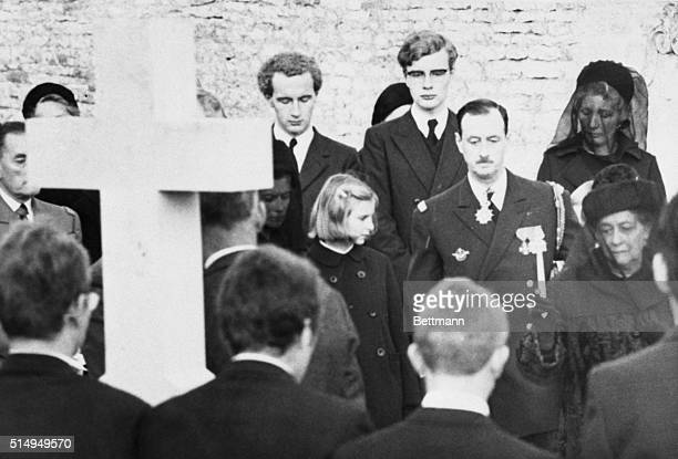 Mme Yvonne de Gaulle sprinkles holy water on the coffin of her husband former French President Charles de Gaulle during a graveside ceremony in the...
