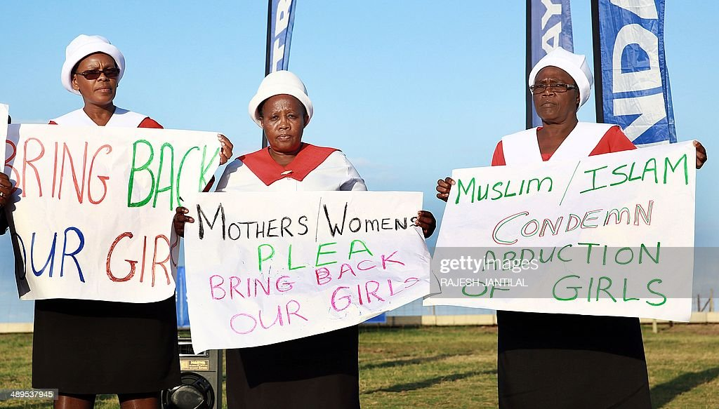 Mmebers of the methodist Church of Southern Africa join people from all faiths to pray for the immediate release of the abducted Nigerian school girls during an interfaith prayer meeting held at the Blue lagoon Beach in Durban on May 11, 2014 .A call from all faiths was for the safe return of the more than 200 girls abducted in Nigeria. AFP PHOTO/ RAJESH JANTILAL