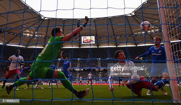 MNicolai Müller of Hamburg has a shot saved by Christian Mathenia of Darmstadt during the Bundesliga match between Hamburger SV and SV Darmstadt 98...