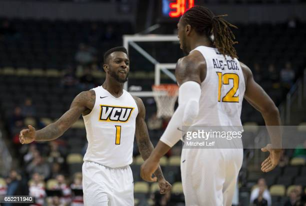 Mo AlieCox celebrates JeQuan Lewis of the Virginia Commonwealth Rams against the Richmond Spiders in the Semifinals of the men's Atlantic 10...