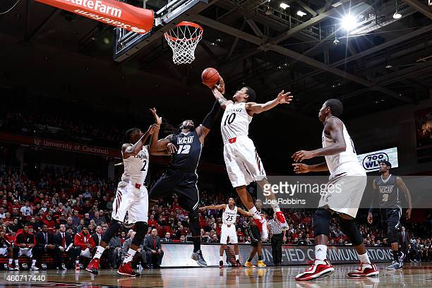 Mo AlieCox of the VCU Rams battles for a rebound against Troy Caupain of the Cincinnati Bearcats in the first half of the game at Fifth Third Arena...