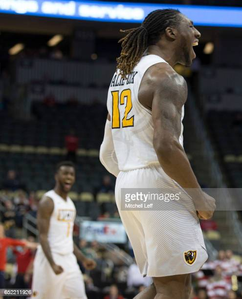 Mo AlieCox of the Virginia Commonwealth Rams and JeQuan Lewis of the Virginia Commonwealth Rams react against the Richmond Spiders in the Semifinals...